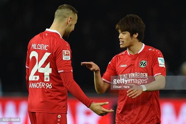 Hiroki Sakai and Alexander Milosevic of Hannover talk during the Bundesliga match between Hertha BSC and Hannover 96 at Olympiastadion on April 8...