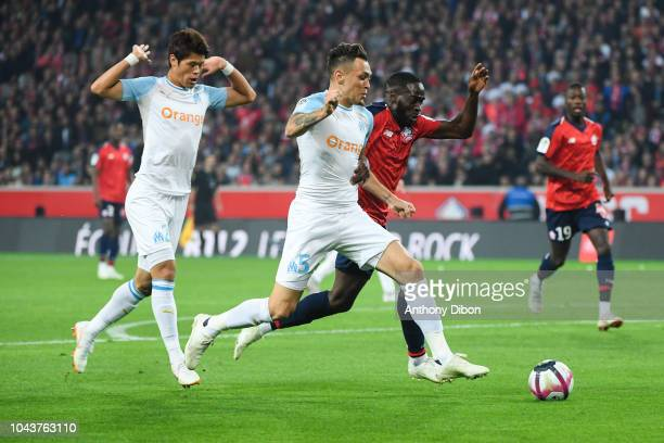 Hiroki Sakai and Lucas Ocampos of Marseille and Jonathan Ikone of Lille during the Ligue 1 match between Lille OSC and Marseille at Stade Pierre...