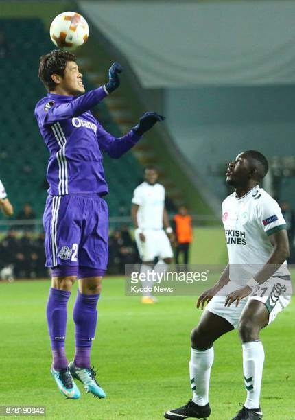 Hiroki Sakai of French club Marseille heads the ball in front of Konyaspor's Fofana in a Europa League soccer groupstage match in Konya Turkey on Nov...