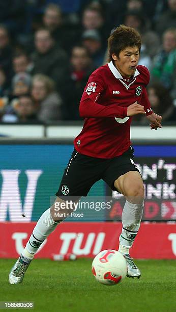 Hiroki Sakai of Hannover runs with the ball during the Bundesliga match between Hannover 96 and SC Freiburg at AWD Arena on November 17, 2012 in...