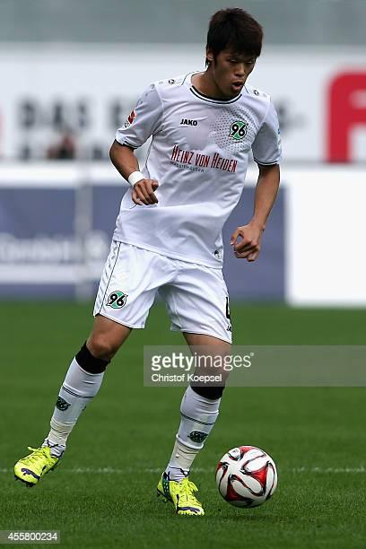 Hiroki Sakai of Hannover runs with the ball during the Bundesliga match between SC Paderborn and Hannover 96 at Benteler Arena on September 20 2014...