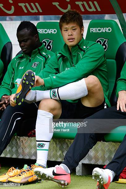 Hiroki Sakai of Hannover sits on the bench before the Bundesliga match between Hannover 96 and Werder Bremen at AWD Arena on September 15 2012 in...