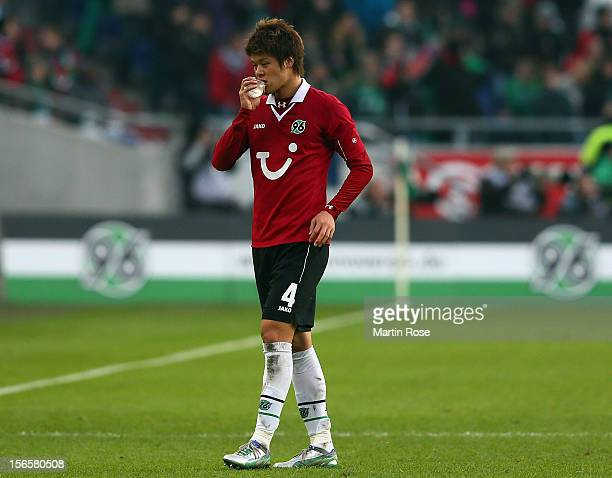 Hiroki Sakai of Hannover takes a break during the Bundesliga match between Hannover 96 and SC Freiburg at AWD Arena on November 17, 2012 in Hannover,...