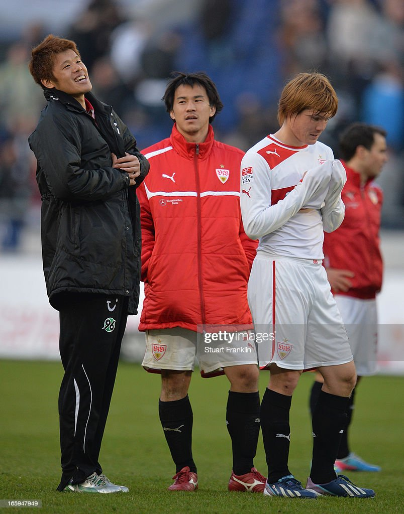 Hiroki Sakai of Hannover talks with Shinji Okazaki and Gotoku Sakai of Stuttgart at the end of the Bundesliga match between Hannover 96 v VfB Stuttgart at AWD Arena on April 7, 2013 in Hannover, Germany.