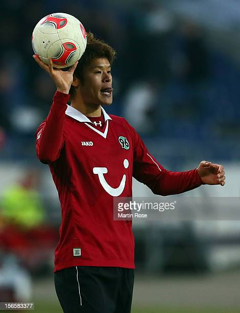 Hiroki Sakai of Hannover trows the ball during the Bundesliga match between Hannover 96 and SC Freiburg at AWD Arena on November 17, 2012 in...
