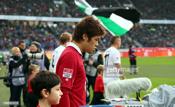 Hiroki Sakai of Hannover walks onto the pitch before the Bundesliga match between Hannover 96 and SC Freiburg at AWD Arena on November 17, 2012 in...