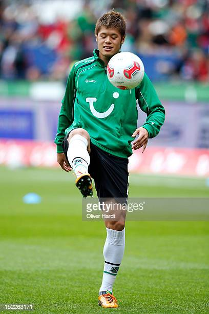 Hiroki Sakai of Hannover warms up before the Bundesliga match between Hannover 96 and Werder Bremen at AWD Arena on September 15 2012 in Hannover...