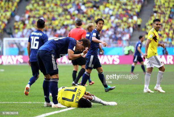 Hiroki Sakai of Japan argues with Johan Mojica during the 2018 FIFA World Cup Russia group H match between Colombia and Japan at Mordovia Arena on...