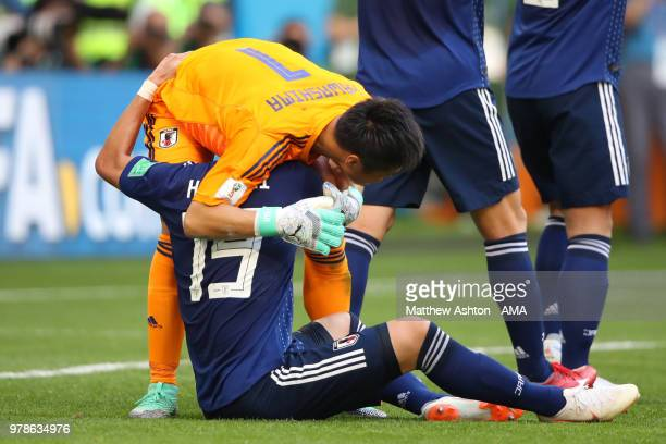 Hiroki Sakai of Japan celebrates with Eiji Kawashima of Japan at the end of the 2018 FIFA World Cup Russia group H match between Colombia and Japan...