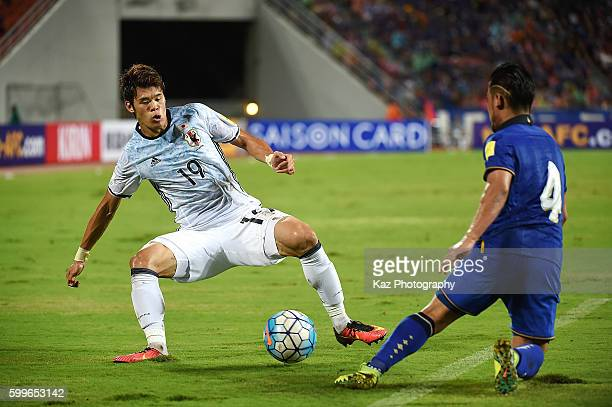 Hiroki Sakai of Japan competes for the ball against Kroekrit Thaweekarn of Thailand during the 2018 FIFA World Cup Qualifier between Thailand and...