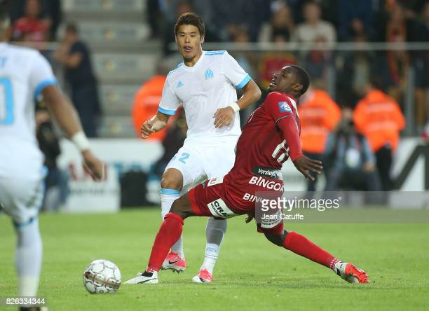 Hiroki Sakai of OM and Joseph Akpala of KV Oostende during the UEFA Europa League third qualifying round second leg match between KV Oostende and...