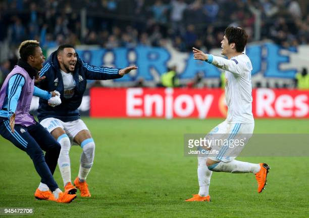 Hiroki Sakai of OM celebrates scoring the fifth goal for Marseille with Clinton Njie and Dimitri Payet during the UEFA Europa League quarter final...