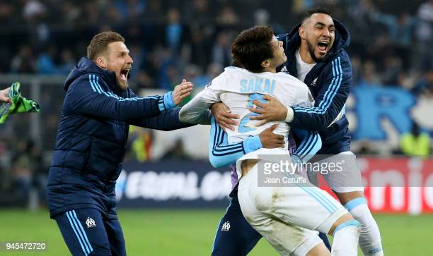 Hiroki Sakai of OM celebrates scoring the fifth goal for Marseille between Gregory Sertic and Dimitri Payet during the UEFA Europa League quarter...