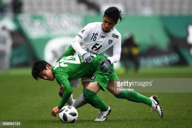 Hiroki Sugajima of Tokyo Verdy and Daisuke Ishizu of Avispa Fukuoka compete for the ball during the JLeague J2 match between Tokyo Verdy and Avispa...