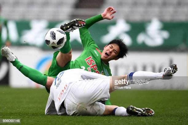 Hiroki Sugajima of Tokyo Verdy and Hisashi Jogo of Avispa Fukuoka compete for the ball during the JLeague J2 match between Tokyo Verdy and Avispa...