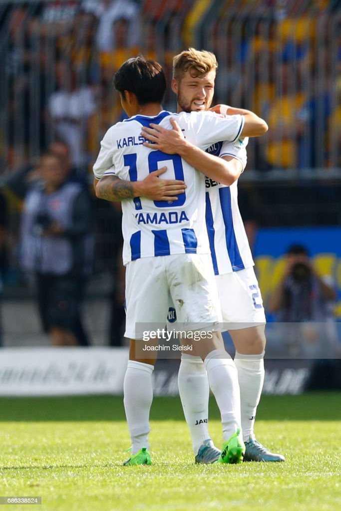 Hiroki Yamada and Yann Rolim of Karlsruhe after the Second Bundesliga match between Eintracht Braunschweig and Karlsruher SC at Eintracht Stadion on May 21, 2017 in Braunschweig, Germany.