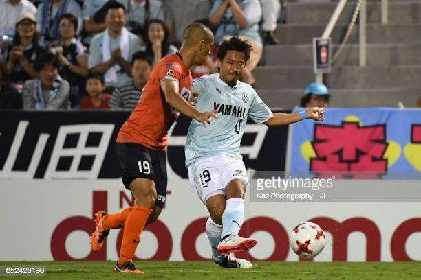 Hiroki Yamada of Jubilo Iwata and Ryo Okui of Omiya Ardija compete for the ball during the J.League J1 match between Jubilo Iwata and Omiya Ardija at...