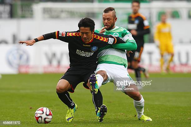 Hiroki Yamada of Karlsruhe is challenged by Stephan Schroeck of Greuther Fuerth during the Second Bundesliga match between Greuther Fuerth and...