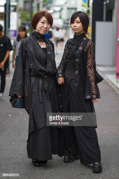 Hiroko and Kure Ha stop for a fashion snap on July 08 2018 in Harajuku Tokyo Japan Hiroko an office worker is wearing HNaoto and carrying a Coach bag...