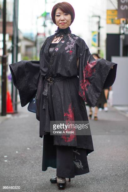 Hiroko and Kure Ha stop for a fashion snap on July 08, 2018 in Harajuku, Tokyo, Japan. Kure Ha is wearing H.Naoto and platform black leather shoes by...