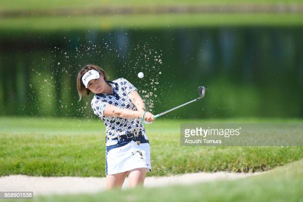 Hiroko Azuma of Japan hits from a bunker on the 8th hole during the final round of Stanley Ladies Golf Tournament at the Tomei Country Club on...