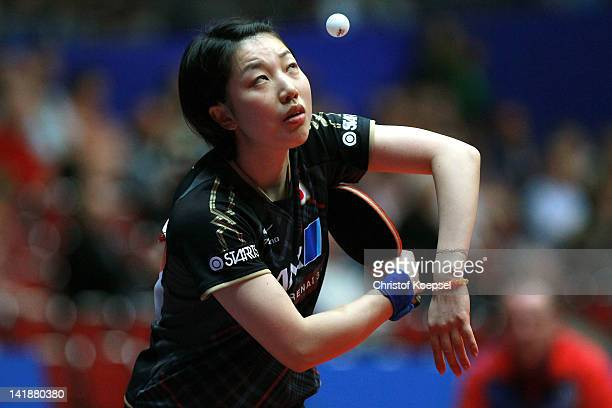 Hiroko Fujii of Japan serves during her match against Monika Molnar of Serbia during the LIEBHERR table tennis team world cup 2012 championship...
