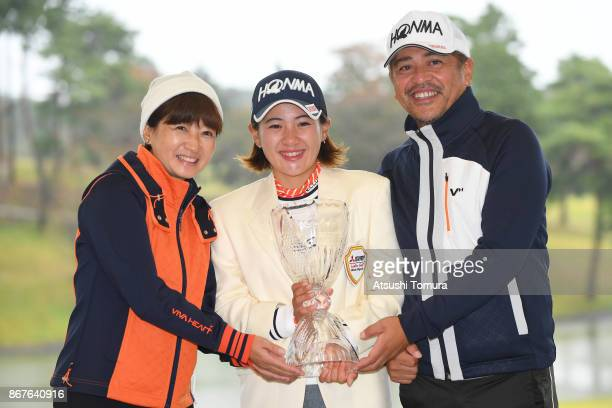 Hiroko Nagai Kana Nagai and Toshiaki Nagai of Japan pose for photographers during award ceremony for the Higuchi Hisako Ponta Ladies at the...