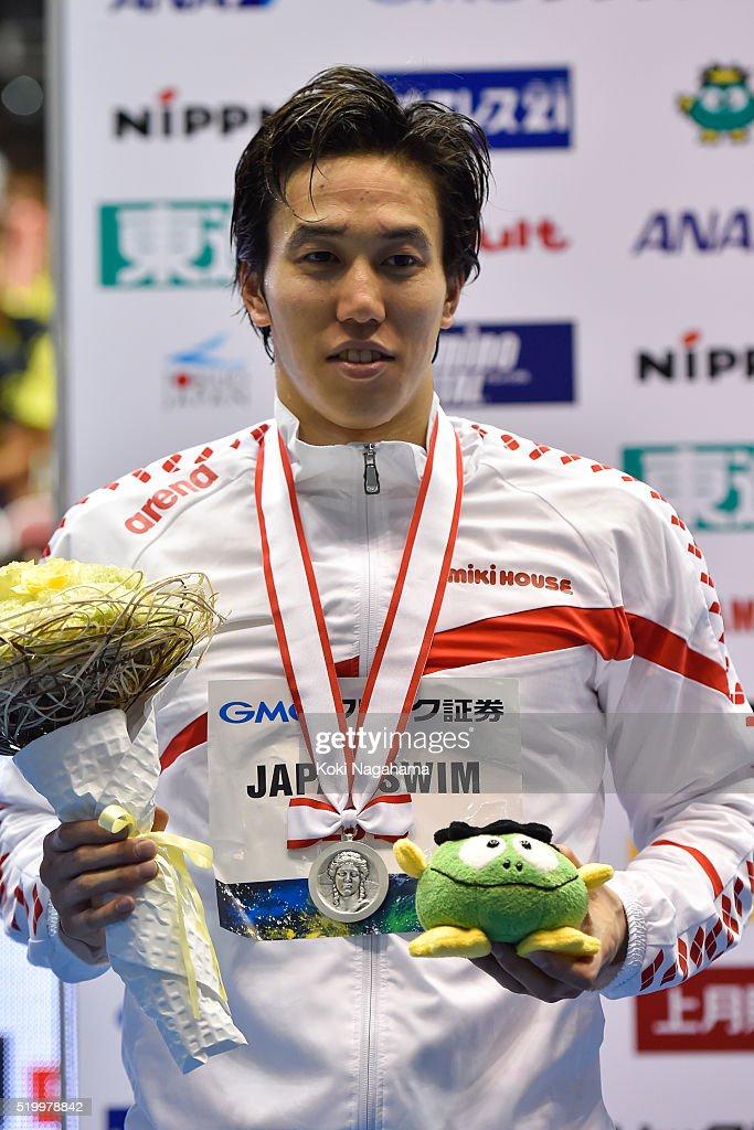 Hiromasa Fujimori (Silver) poses for photographs on the podium after the Men's 200m Individual medley final during the Japan Swim 2016 at Tokyo Tatsumi International Swimming Pool on April 9, 2016 in Tokyo, Japan.