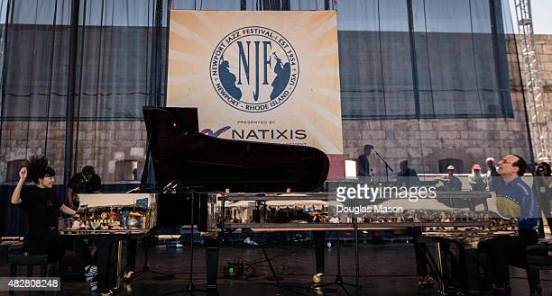 Hiromi and Michel Camilo perform together during the Newport Jazz festival 2015 at Fort Adams State Park on August 2 2015 in Newport Rhode Island