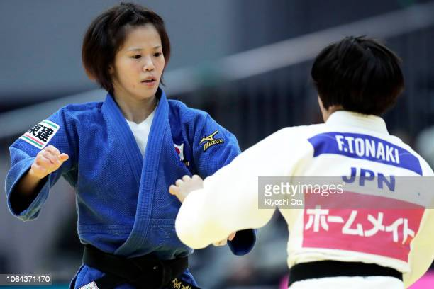 Hiromi Endo of Japan competes against Funa Tonaki of Japan in the Women's 48kg semifinal match on day one of the Grand Slam Osaka at Maruzen Intec...