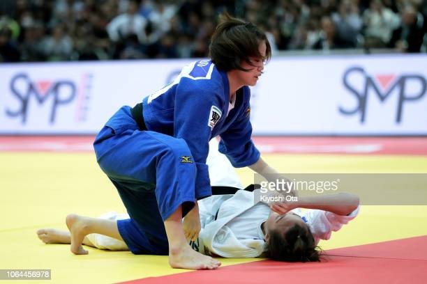 Hiromi Endo of Japan reacts after winning the Women's 48kg bronze medal match against Melanie Clement of France on day one of the Grand Slam Osaka at...