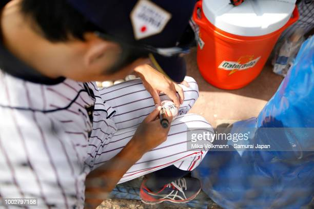 Hiromi Ito of Japan autographs a ball prior the Haarlem Baseball Week game between Japan and Chinese Taipei at Pim Mulier Stadion on July 20 2018 in...