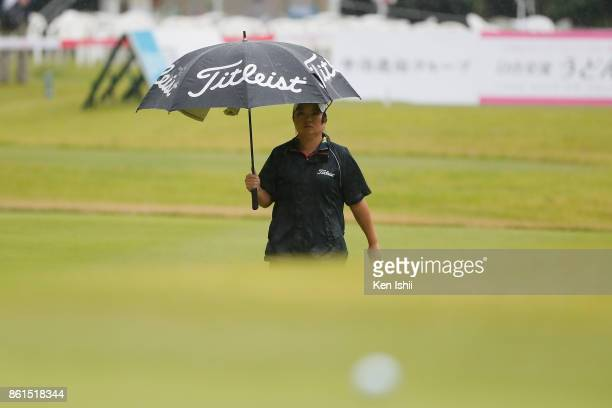 Hiromi Kamata of Japan walks down the 17th hole during the final round of the Udonken Ladies at the Mannou Hills Country Club on October 15 2017 in...