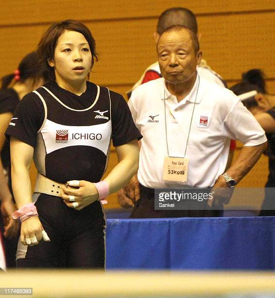 Hiromi Miyake and his father and coachYoshiyuki Miyake look on during the 25th All Japan Women's Weightlifting Championships at Saitama City Memorial...