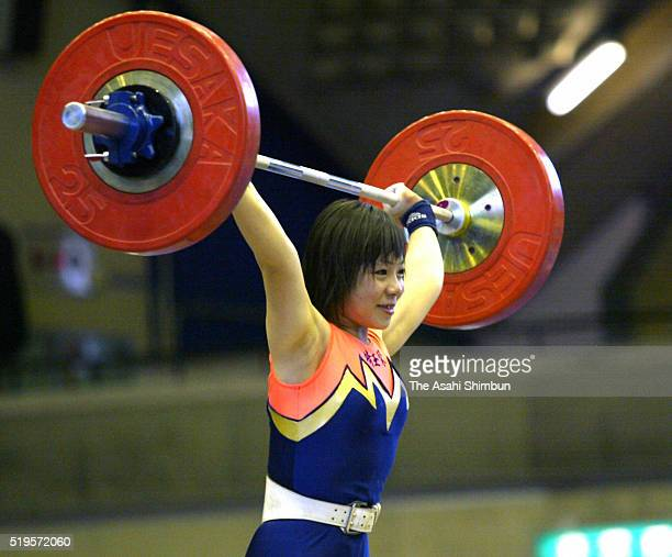 Hiromi Miyake competes in the Women's -53kg during the 16th All Japan Women's Weightlifting Championships at the Ota City Gymnasium on May 25, 2002...