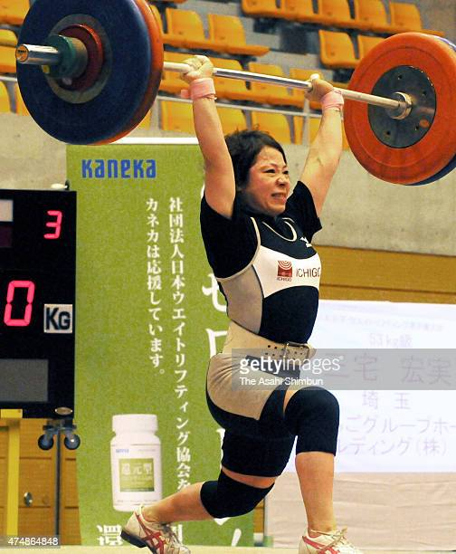 Hiromi Miyake competes in the Women's 53kg during the All Japan Weightlifting Championships at Saitama City Memorial Gymnasium on June 24, 2011 in...