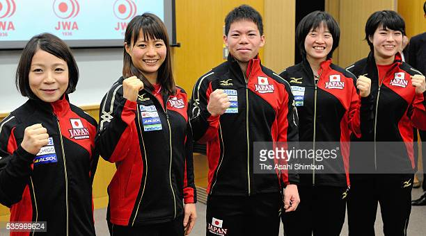 Hiromi Miyake Kanae Yagi Yoichi Itokazu Mikiko Ando and Namika Matsumoto pose for photographs during the Japan Weightlifting team press conference on...