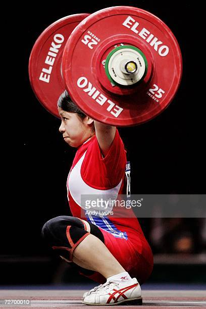 Hiromi Miyake of Japan attempts a lift in the Women's 48kg Group A weightlifting at the 15th Asian Games Doha 2006 at Al-Dana Banquet Hall on...