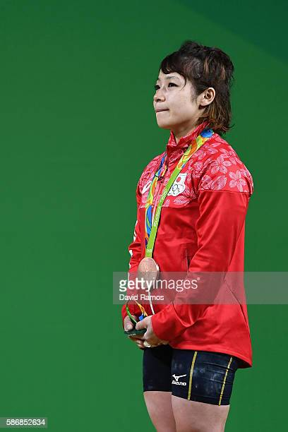 Hiromi Miyake of Japan celebrates after winning the bronze medal in the Women's 48kg Group A Final on Day 1 of the Rio 2016 Olympic Games at...