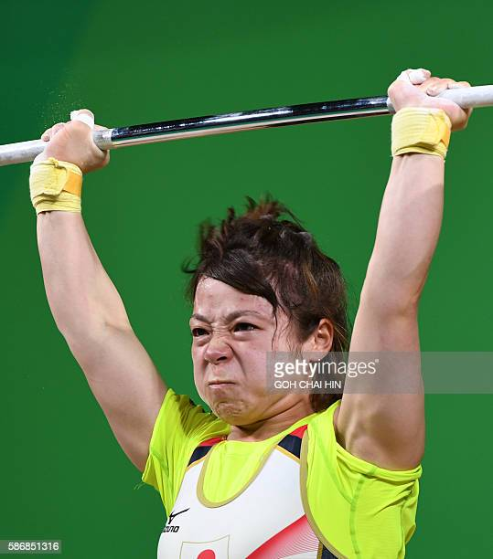 Hiromi Miyake of Japan competes in the women weightlifting 48kg competition during the Rio 2016 Olympic Games at the Riocentro Pavilion in Rio de...
