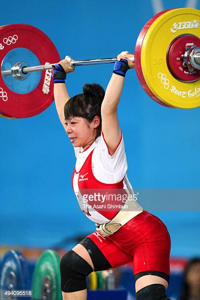 Hiromi Miyake of Japan competes in the Women's -48kg Group A Weightlifting event held at the Beijing University of Aeronautics and Astronautics...