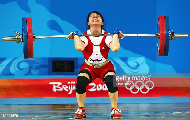Hiromi Miyake of Japan competes in the Women's 48kg Group A Weightlifting event held at the Beijing University of Aeronautics and Astronautics...