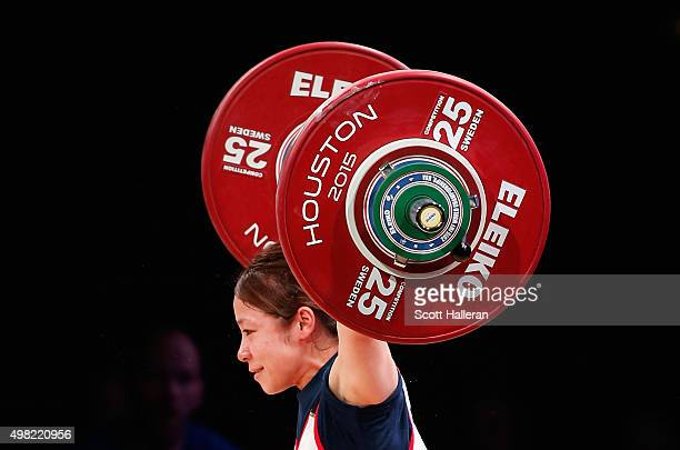 Hiromi Miyake of Japan competes in the women's 48kg weight class during the 2015 International Weightlifting Federation World Championships at the...