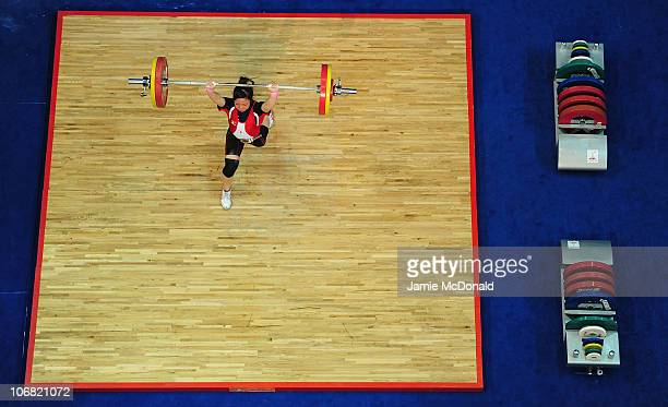 Hiromi Miyake of Japan competes in the Women's 53 kg event at the Dongguan Gymnasium during day two of the 16th Asian Games Guangzhou 2010 on...