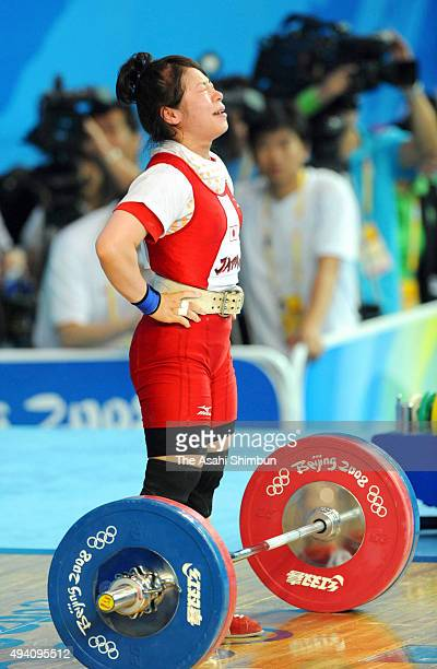 Hiromi Miyake of Japan reacts after competing in the Women's -48kg Group A Weightlifting event held at the Beijing University of Aeronautics and...