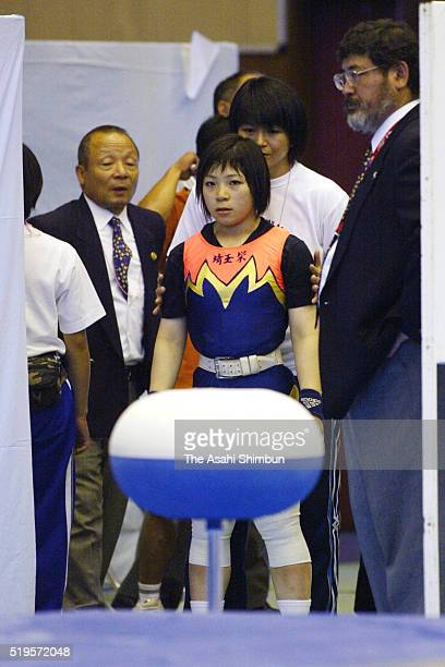 Hiromi Miyake prepares to compete in the -53kg during the 16th All Japan Women's Weightlifting Championships at the Ota City Gymnasium on May 25,...