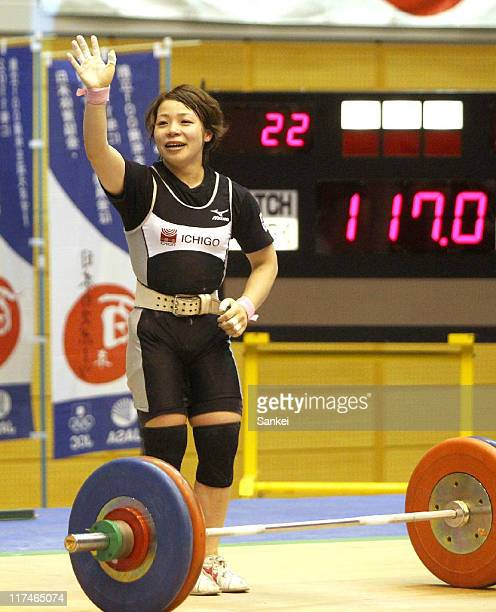 Hiromi Miyake waves to the crowd after winning in the 53kg class during the 25th All Japan Women's Weightlifting Championships at Saitama City...