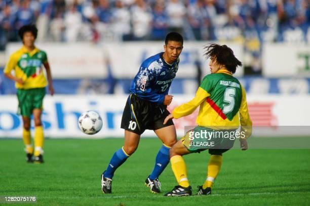 Hiromitsu Isogai of Gamba Osaka and Kazuhiro Suzuki of JEF United Ichihara compete for the ball during the J.League match between Gamba Osaka and JEF...