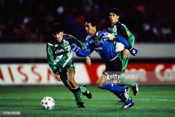 Hiromitsu Isogai of Gamba Osaka and Kentaro Hayashi of Verdy Kawasaki compete for the ball during the J.League Nicos Series match between Gamba Osaka...