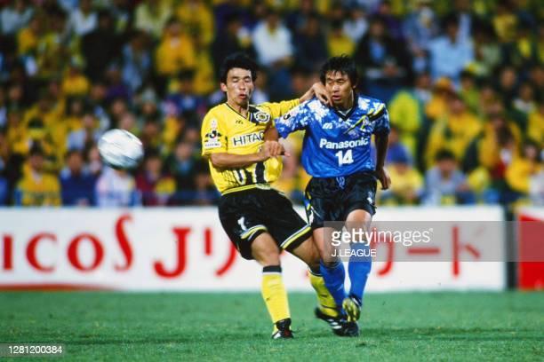 Hiromitsu Isogai of Gamba Osaka and Michihisa Date of Kashiwa Reysol compete for the ball during the J.League match between Kashiwa Reysol and Gamba...